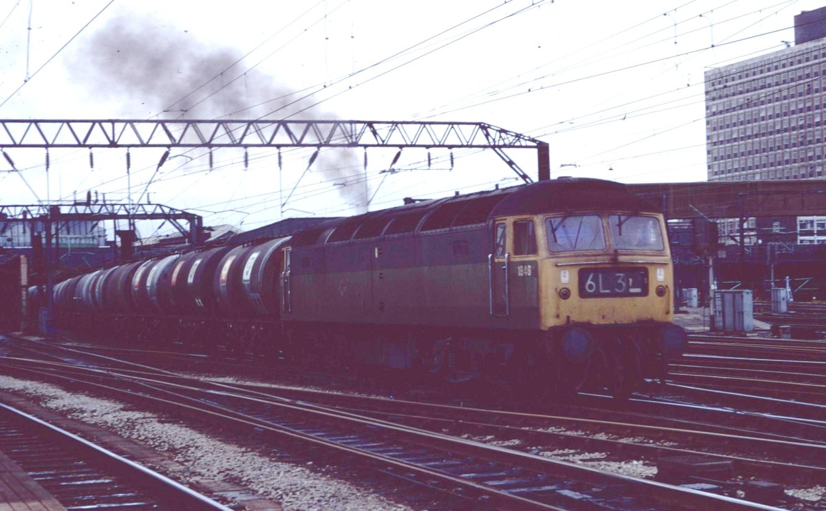 Above: This undated shot from our loco's early years shows it in its original livery of two tone green with the addition of full yellow ends. It is heading a train of oil tank wagons through Crewe station. Photo: Class 47 Preservation Project Archive.